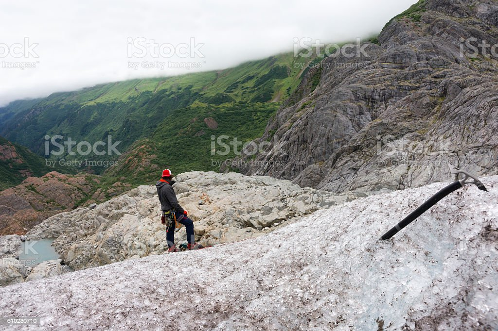 Guide on icy glacier slope stock photo