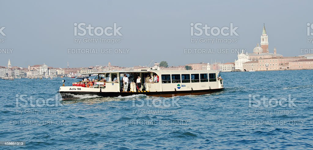 Guidecca Canal in Venice and Vaporetto royalty-free stock photo