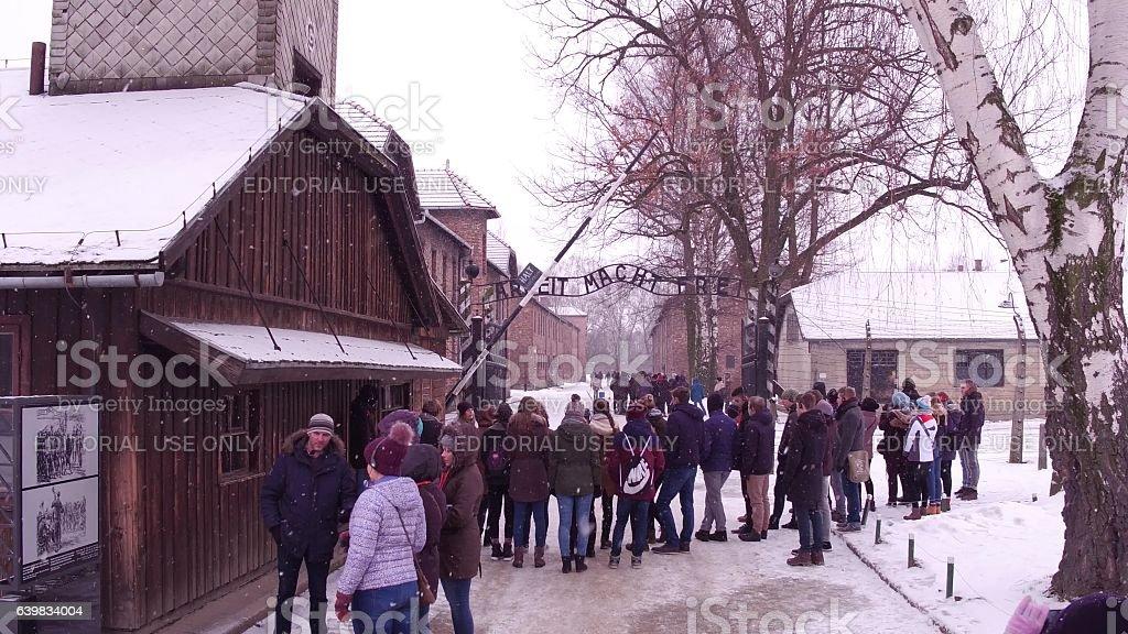 OSWIENCIM, POLAND - JANUARY, 14, 2017 Guided tour near entrance stock photo