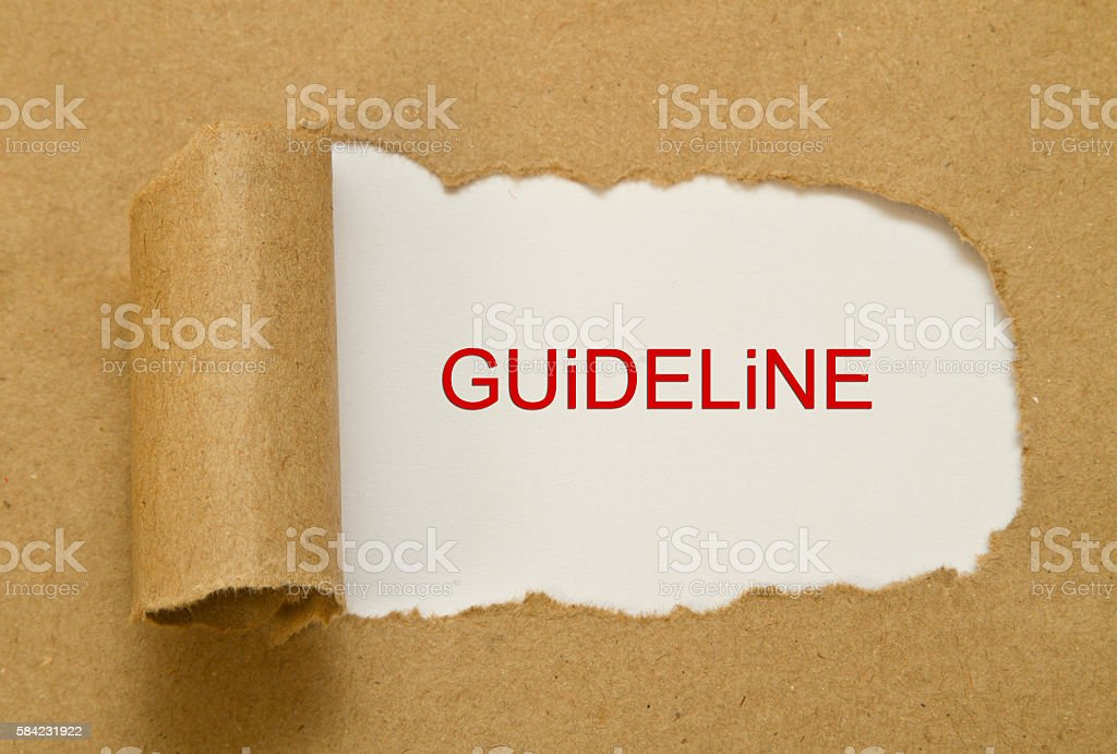Guideline word written under brown torn paper stock photo