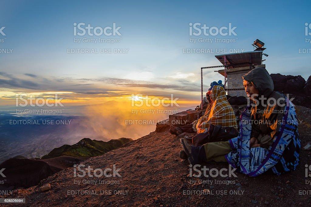 Guides waiting at mount Merapi's summit stock photo