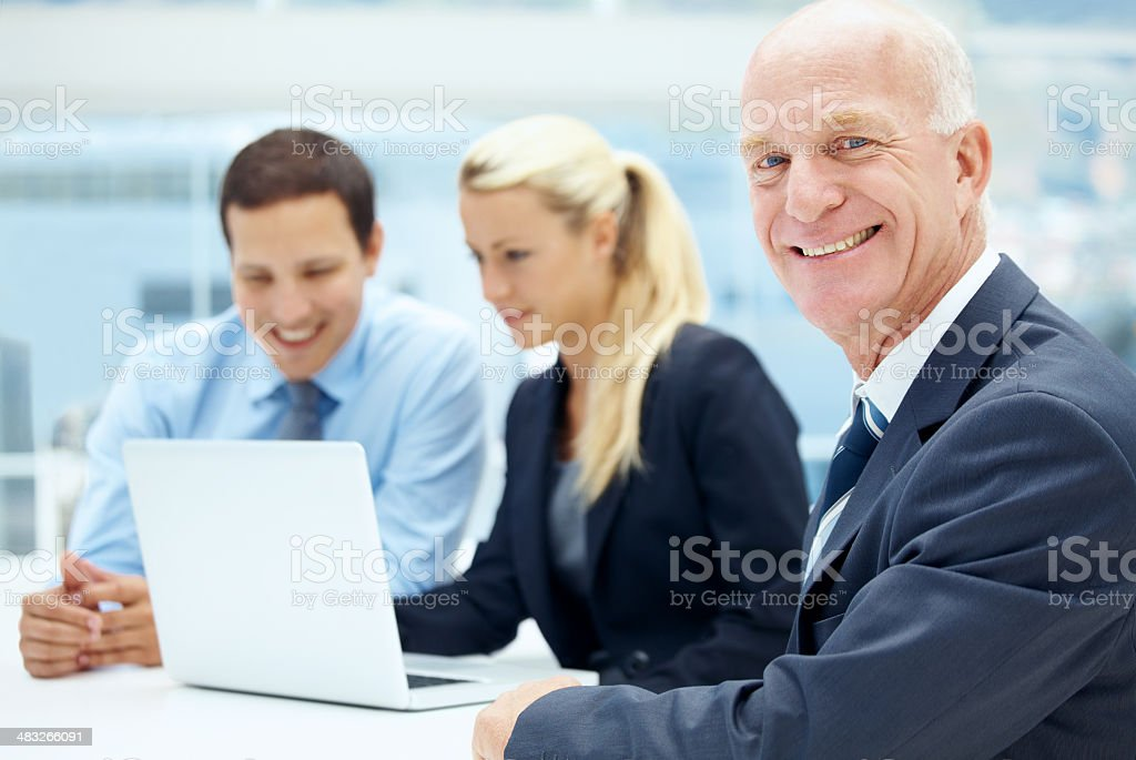 Guiding them with his wealth of experience stock photo