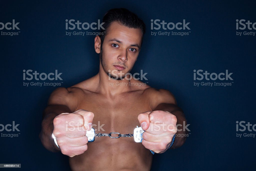 Guilty man with handcuffs stock photo
