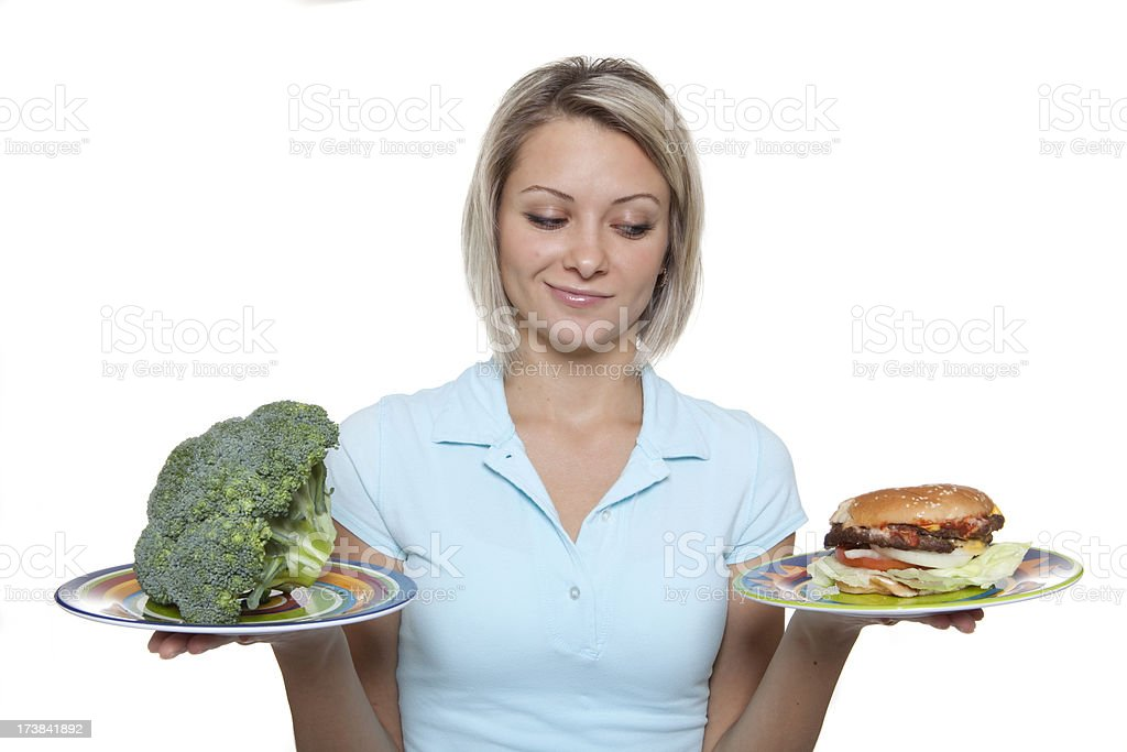 Guilty Pleasure of a Hamburger or The Healthy Broccoli royalty-free stock photo