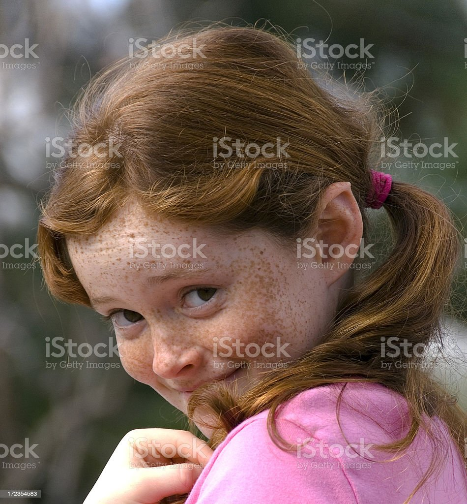 Guilty & Shy Child, Mischievious Redhead Freckle Face Pre Adolescent Girl stock photo