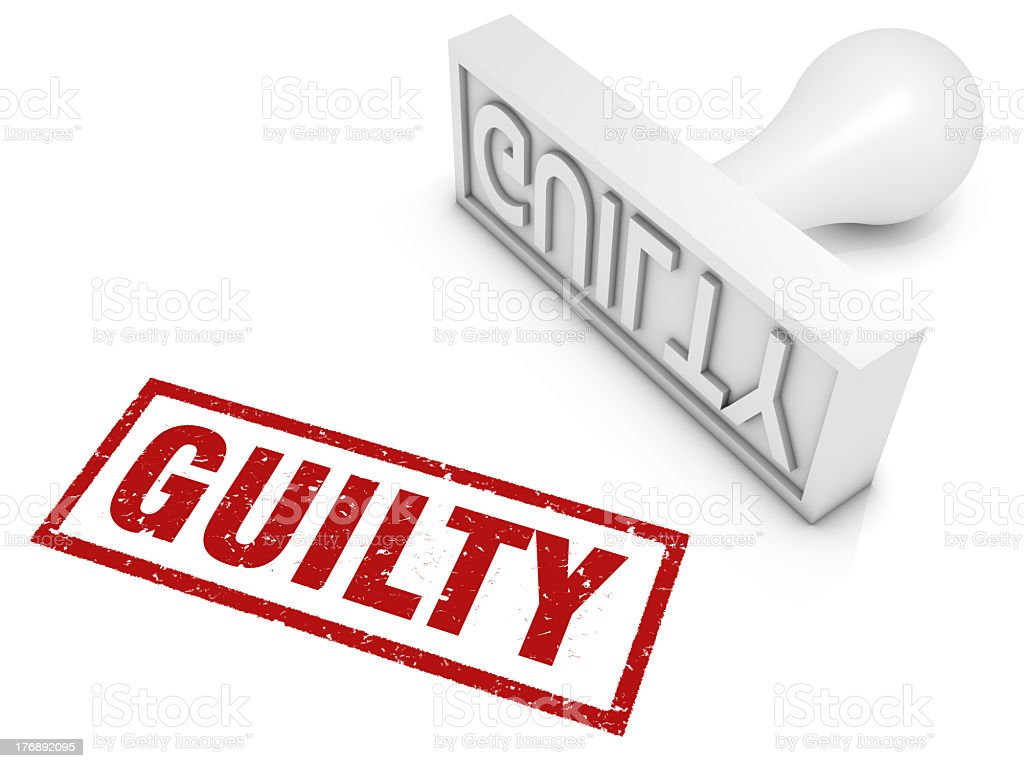Guilty stamp in red on white desk stock photo
