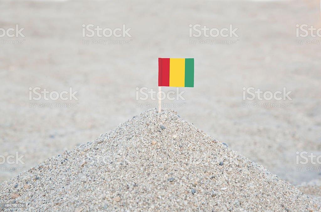 Guinea Flag on the Beach stock photo