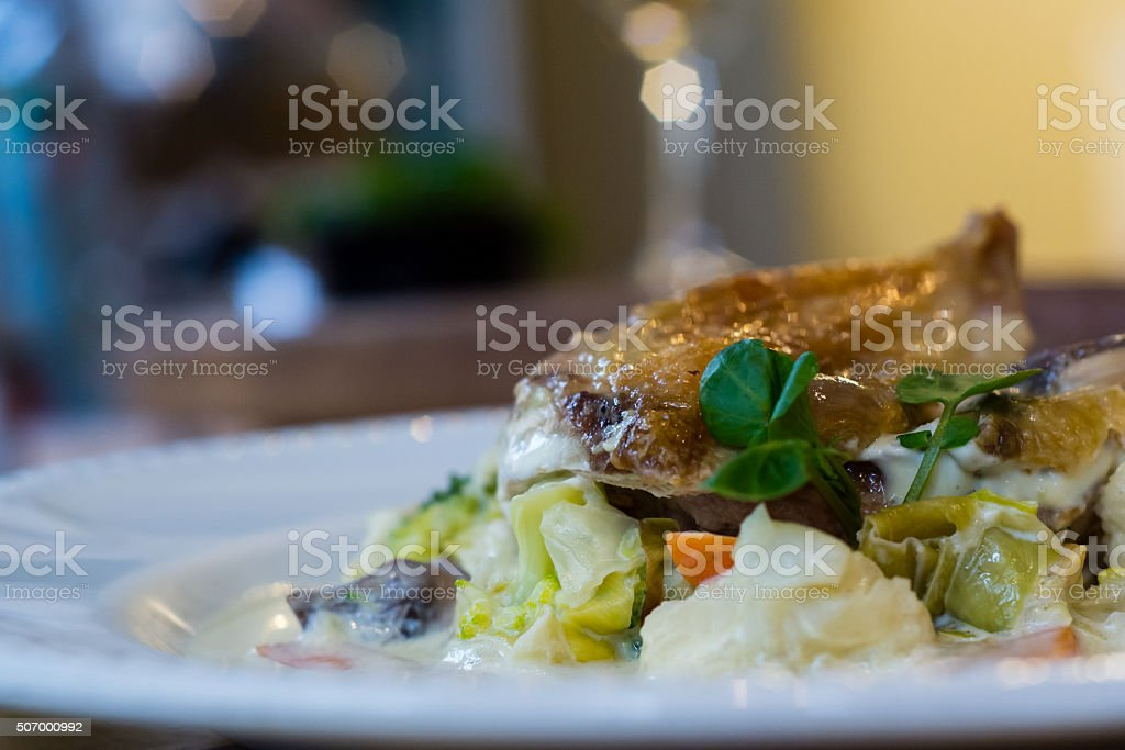 Guinea fowl breast, mustard sauce and mixed vegetables from side stock photo