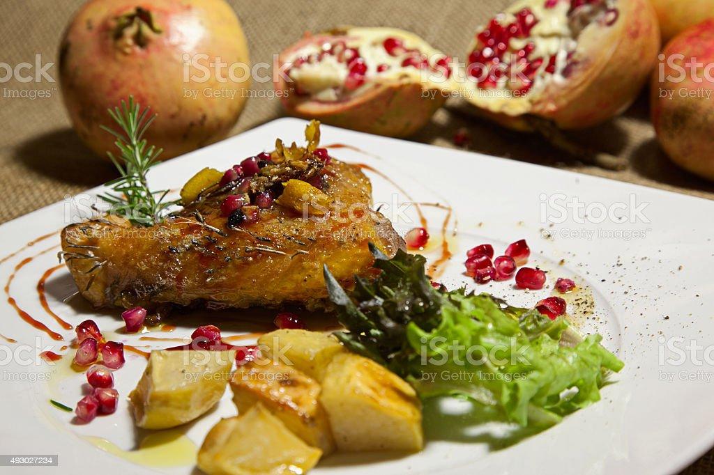 Guinea fowl with pomegranate stock photo