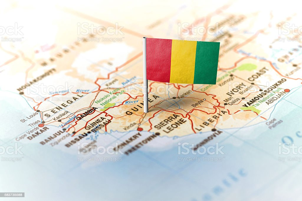 Guinea pinned on the map with flag stock photo