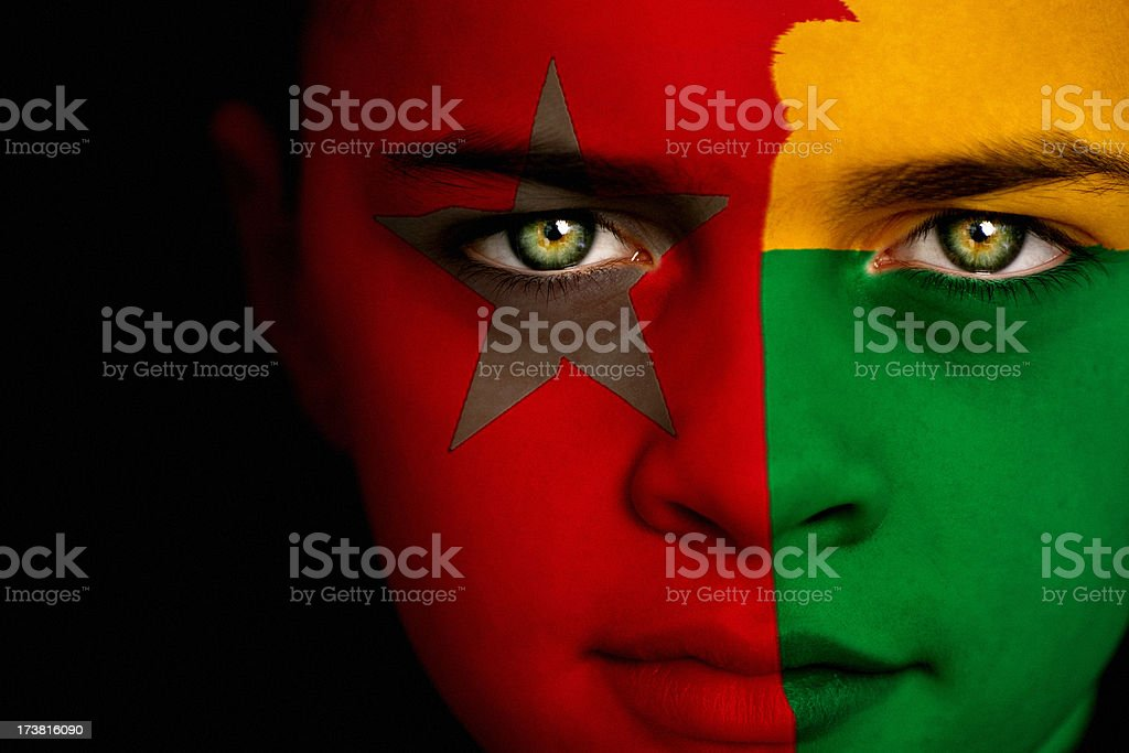 Guinea-Bissau flag boy royalty-free stock photo