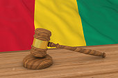 Guinean Law Concept - Flag of Guinea Behind Judge's Gavel