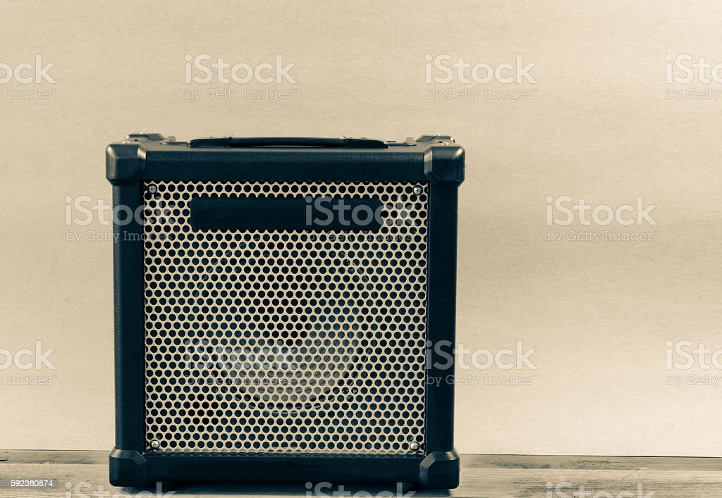 Guitar amplifier isolated  on a  light brown stock photo