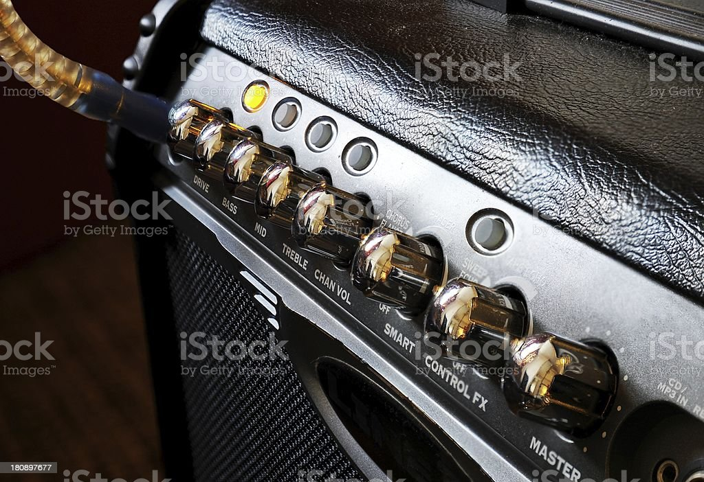 Guitar amplifier with light on and cable connected royalty-free stock photo