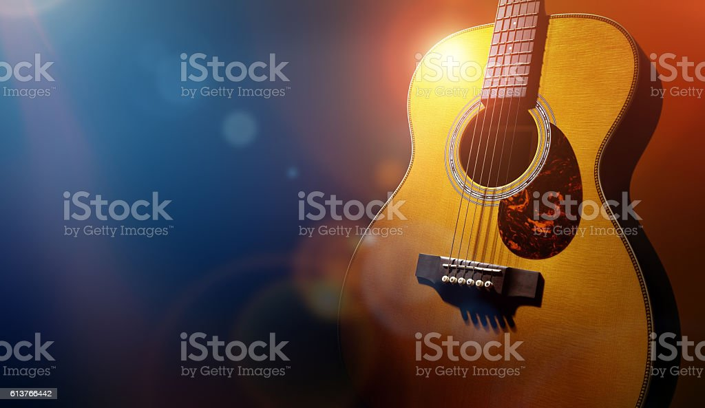 Guitar and blank grunge stage background stock photo