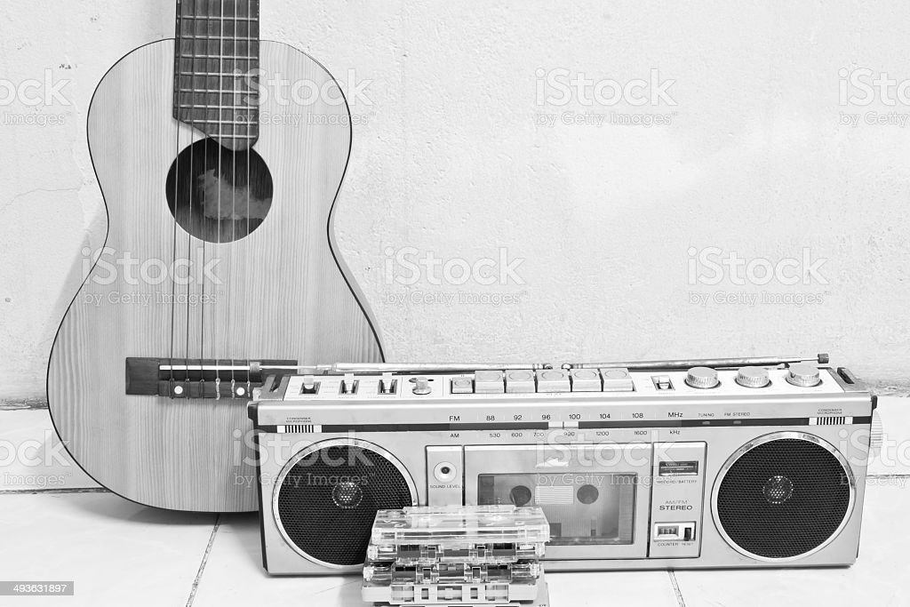 guitar and cassette player stock photo