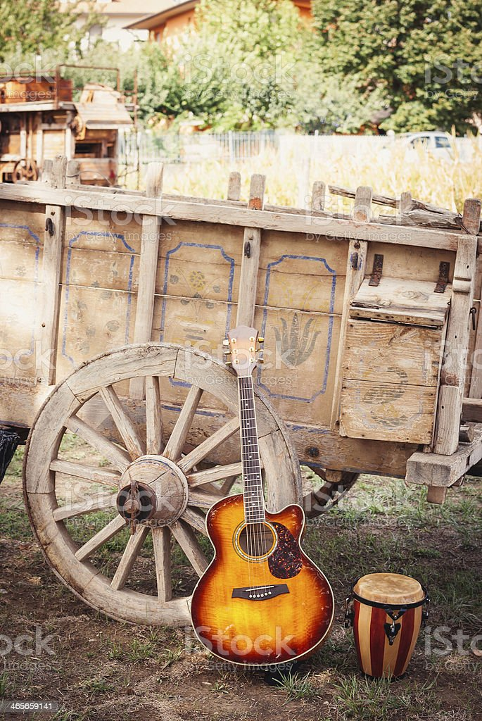 Guitar And Drum Lening On A Horsecart stock photo