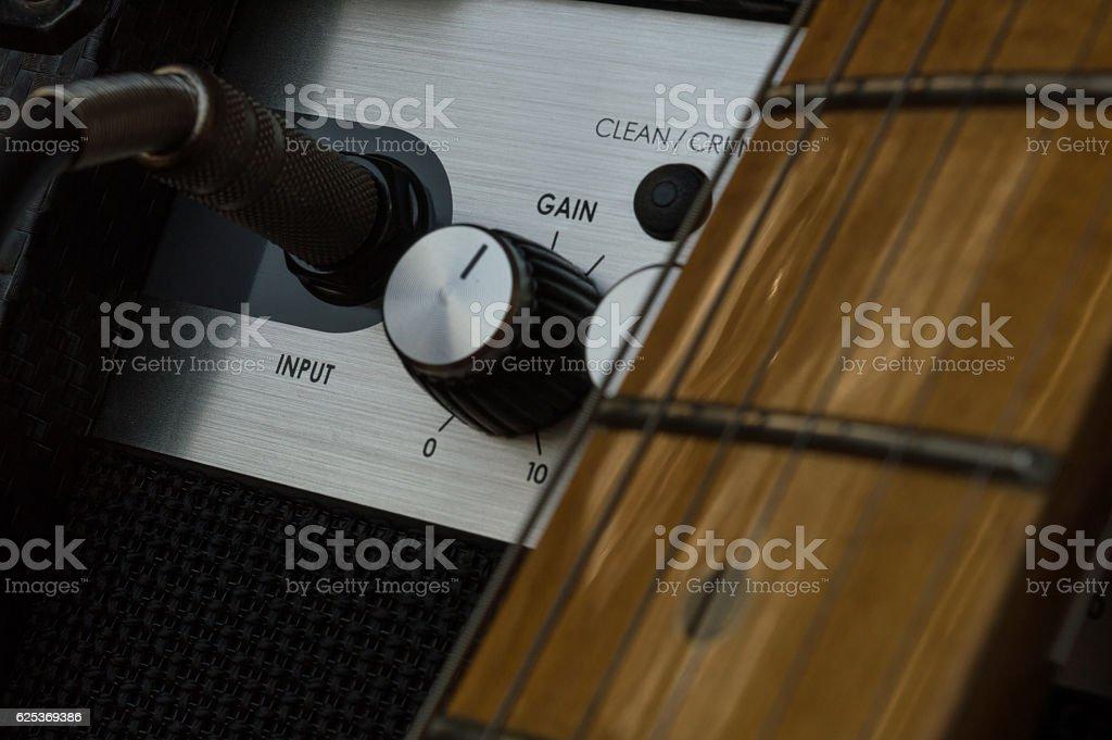 Guitar and gain stock photo