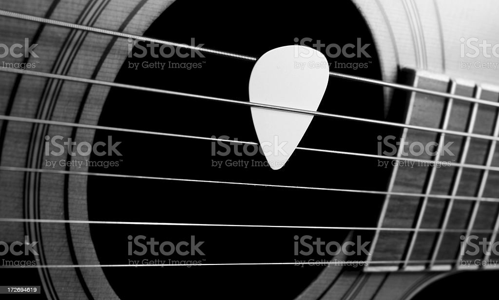 Guitar and plectrum royalty-free stock photo