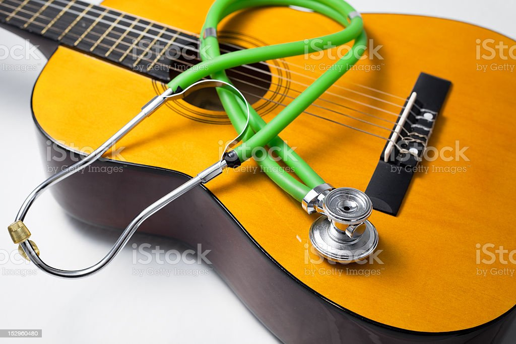 Guitar and stethoscope. royalty-free stock photo