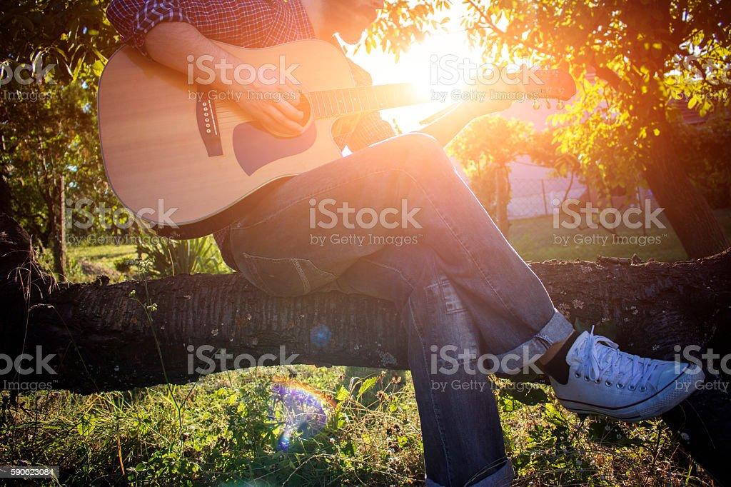 Guitar and sunset stock photo