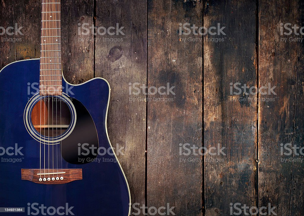 Guitar and wood background stock photo
