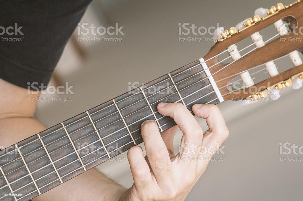Guitar chord: D minor stock photo