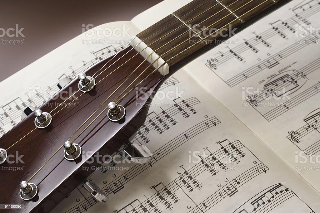 Guitar close up on sheet music royalty-free stock photo