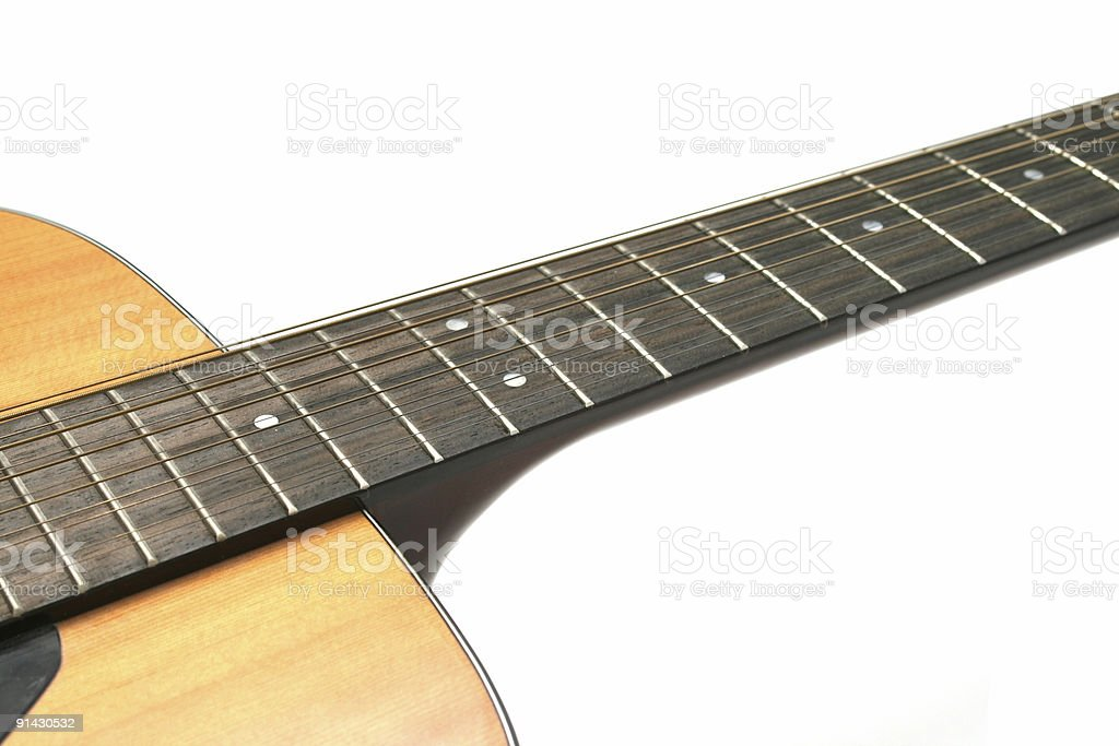 guitar closeup of neck and body against a white background stock photo