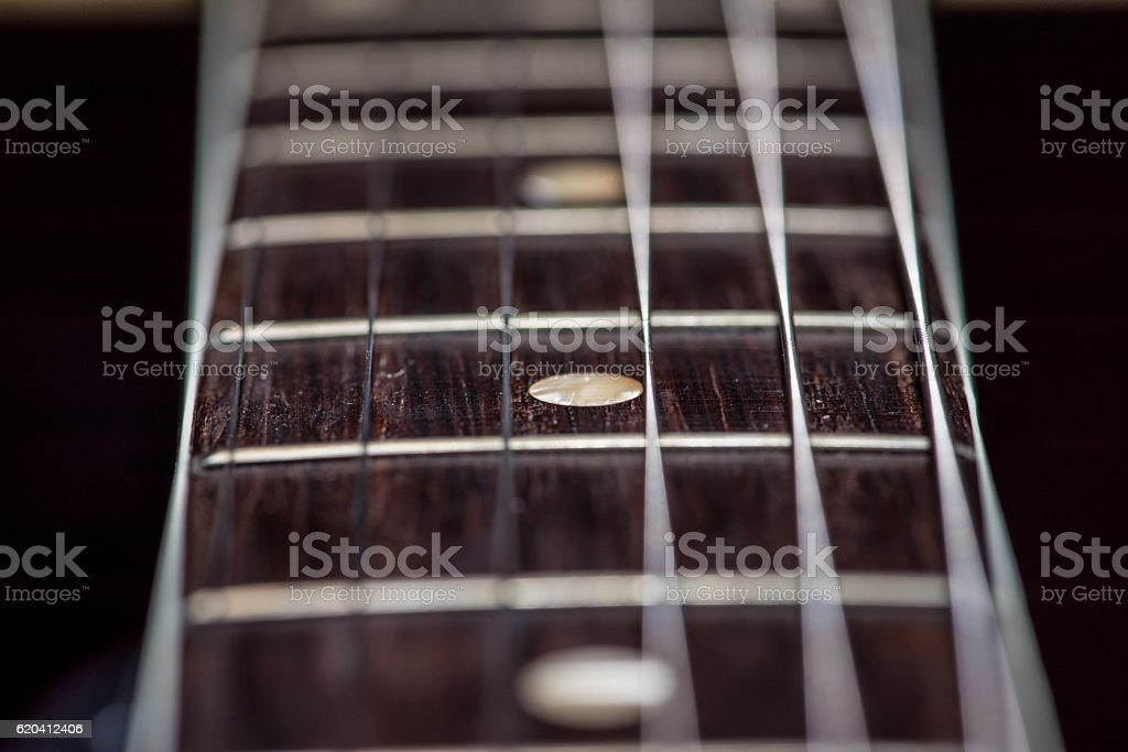Guitar fret board and strings stock photo