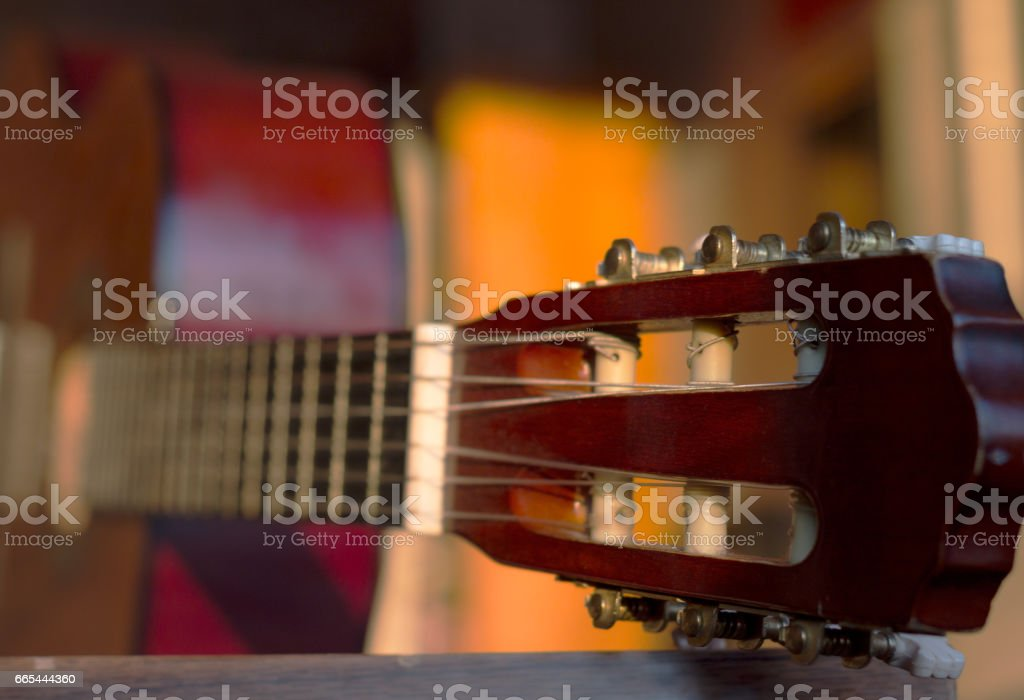 Guitar headstock, close up, with very shallow depth of field stock photo
