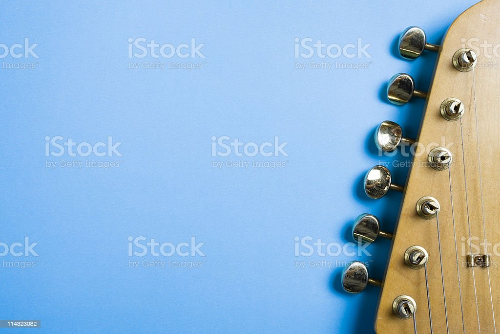 Guitar headstock on blue stock photo