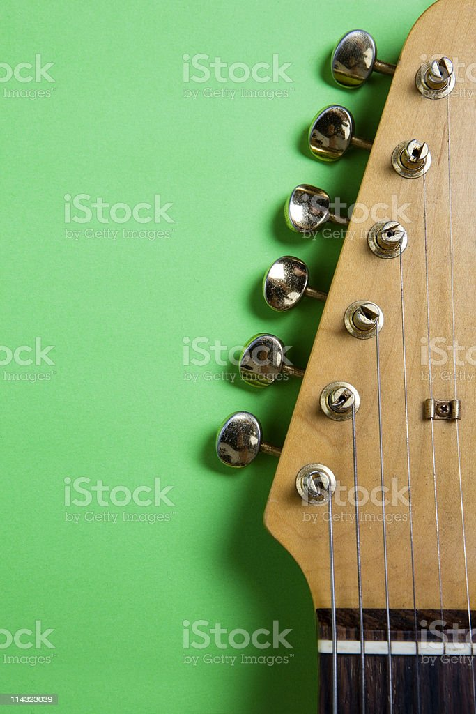 Guitar headstock on green stock photo