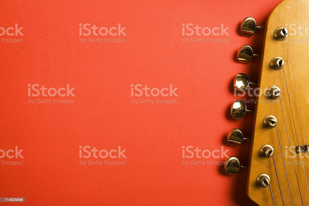 Guitar headstock on red stock photo