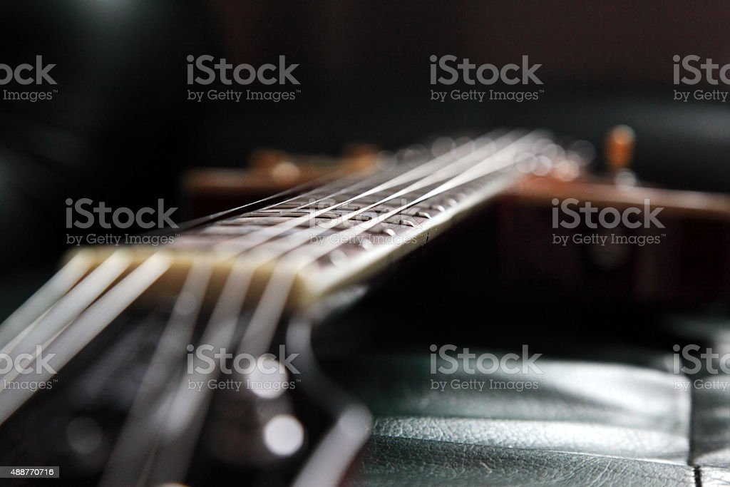 Guitar in dark room stock photo