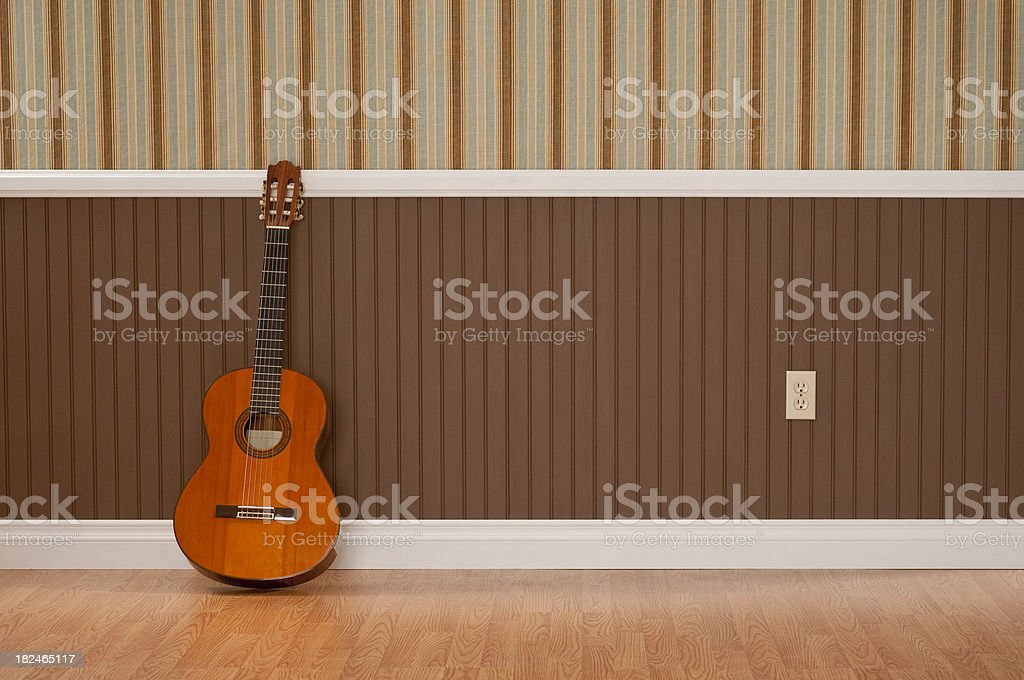 Guitar In Empty Room royalty-free stock photo