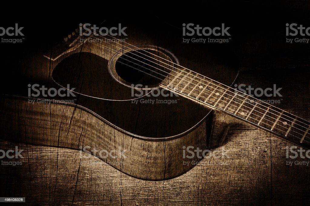 guitar in wood texture background stock photo