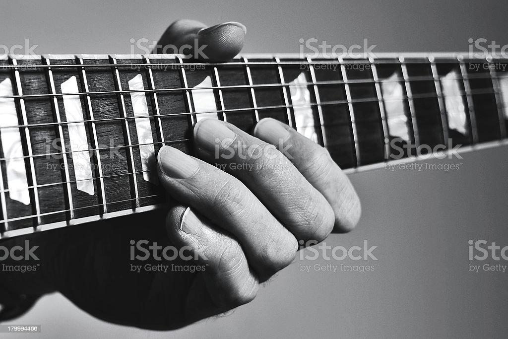 Guitar lessons, fingers on fretboard stock photo