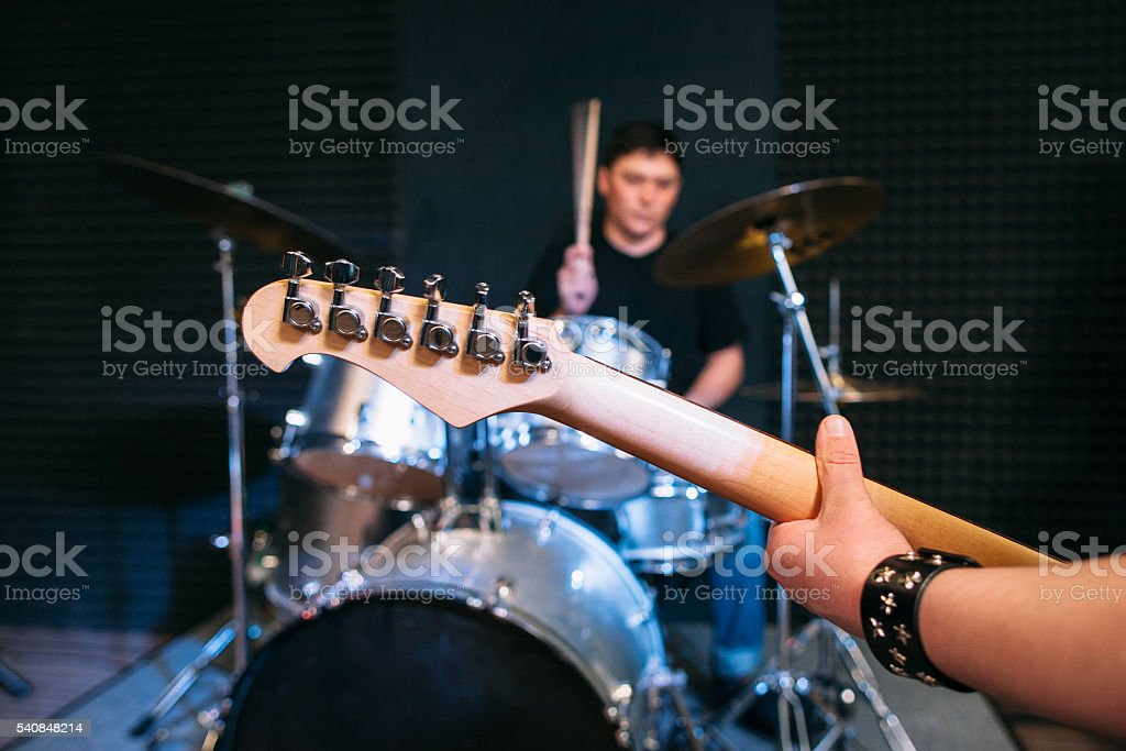 Guitar neck close-up on drum set background stock photo