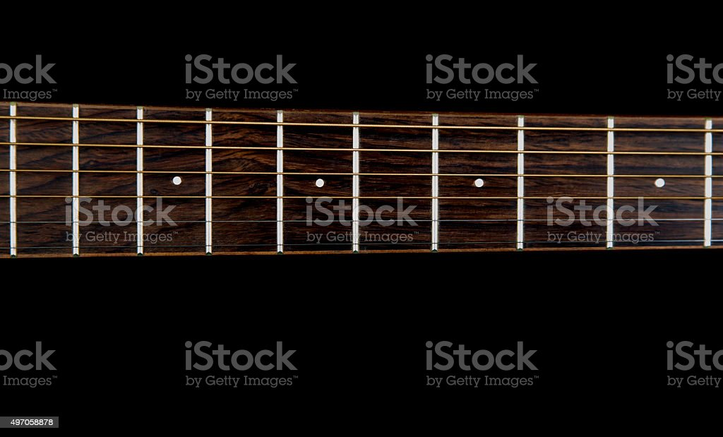 Guitar neck on a Black Background stock photo