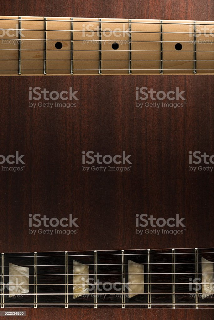 Guitar necks over wooden background stock photo