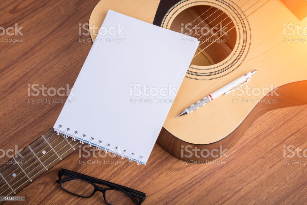 guitar notebook, pencil and eyeglasses stock photo