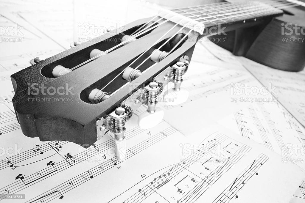guitar on music sheet, headstock closeup stock photo