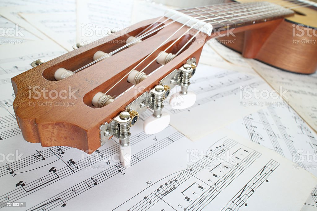 guitar on music sheet stock photo