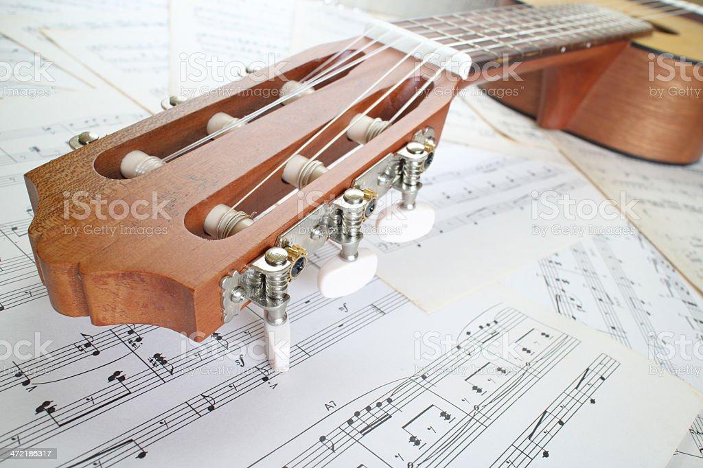 guitar on music sheet stock photo