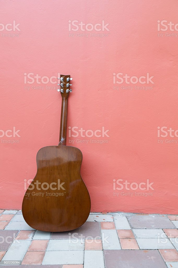 guitar on old wall stock photo