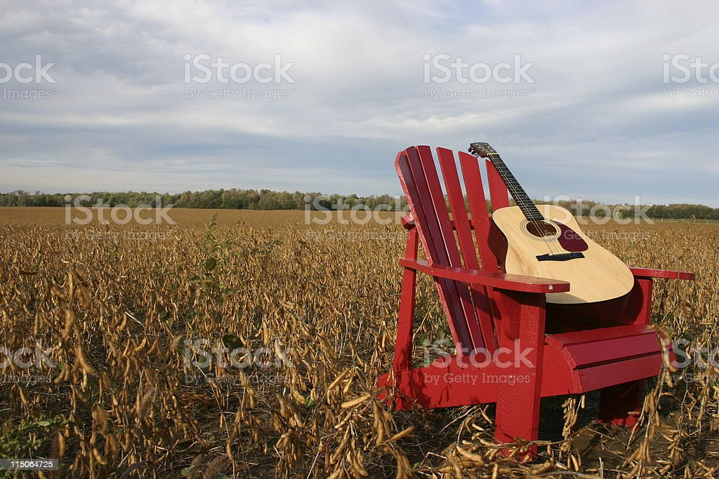 guitar on red  chair stock photo