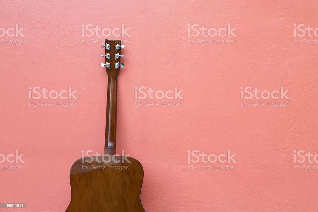 Guitar on wall stock photo