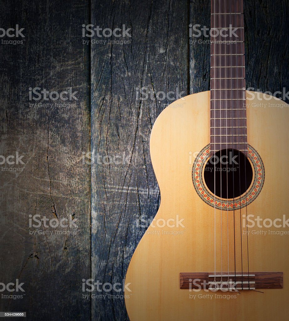 Guitar on wood background. stock photo