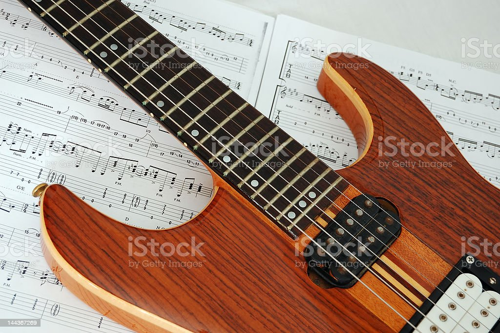 Guitar over sheetmusic stock photo